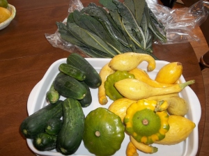 Squash for a loaf of bread, cukes and kale for a loaf of bread