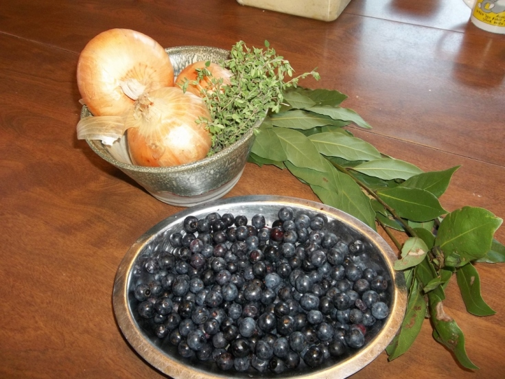 Big bowl of blueberries, fresh bay leaves, fresh thyme, vidalia onions and a beautiful pottery bowl.