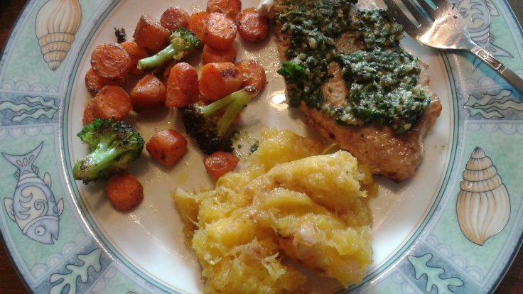 Grilled salmon topped with a good spoonful of pesto with a side of acorn mashed squash, carrots and broccoli.