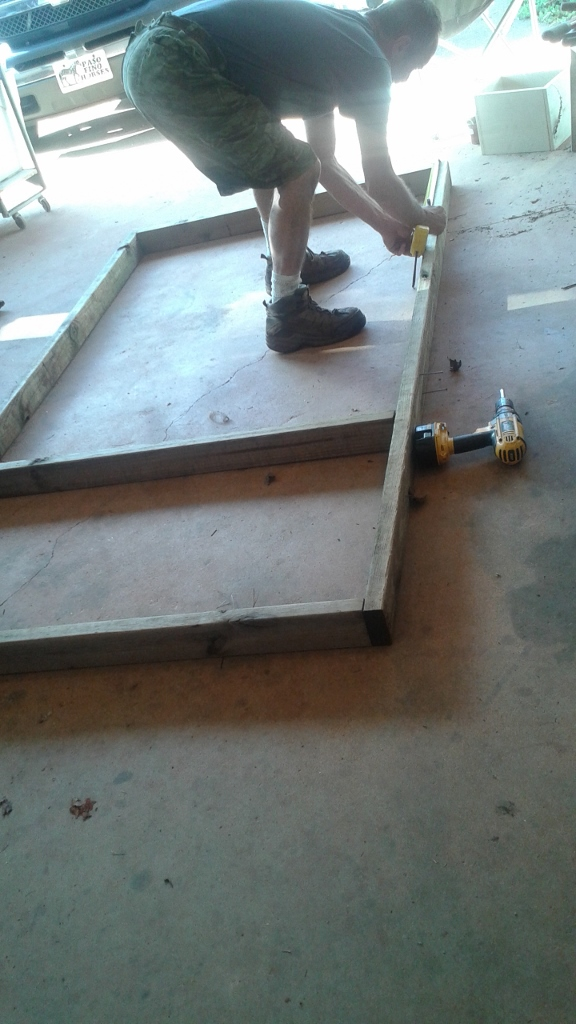 Adding and moving some of the boards from the base of chicken tractor