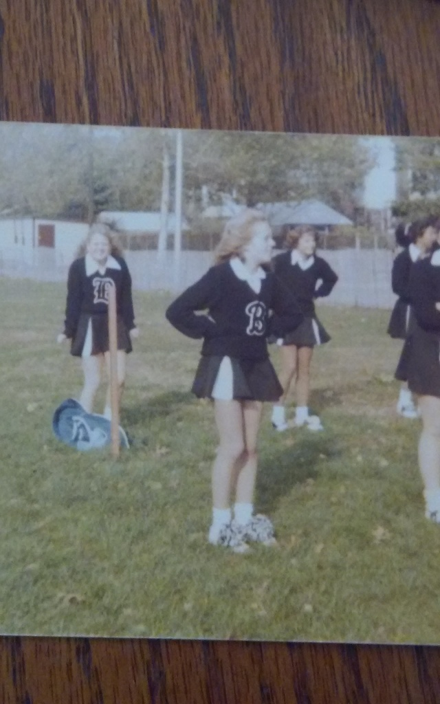 Me in the back freezing during cheerleading